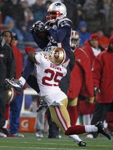 Brandon Lloyd went high to catch this pass from Tom Brady in the second quarter.
