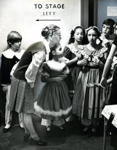 December 11, 1975: Sydney Leonard, ballet mistress of the Boston Ballet, offered some last-minute advice to younger members of the cast of the company's annual holiday presentation of Tchaikovsky's
