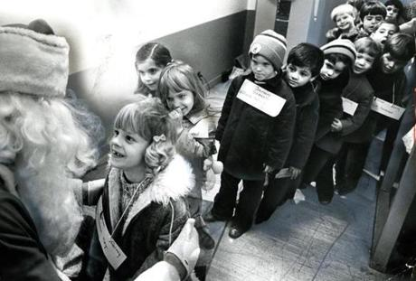 December 5, 1972:  Kindergartners at the Willard School in Quincy waited eagerly to tell Santa their wish list. No surprise, the first little girl's wish might have been for her