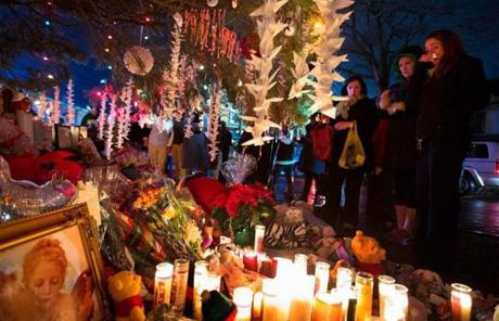 Items left by mourners were at a memorial in Newtown.