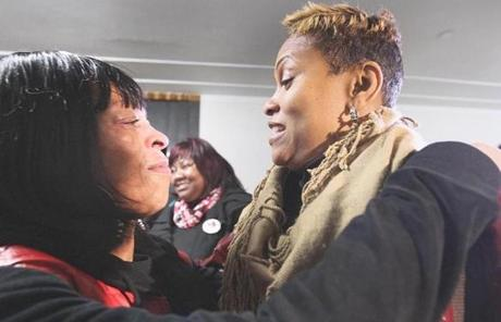 Patricia Washum-Bennett (right), mother of slain Levaughn Washburn-Garrison, celebrated.