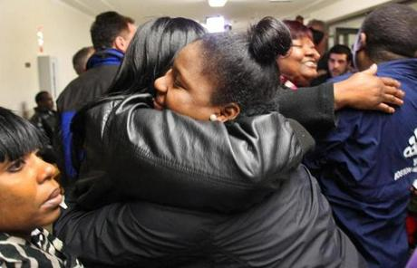 Relatives of the victims embraced after the sentencing of Dwayne Moore to life in prison without parole.
