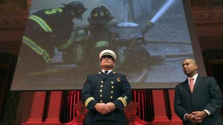 Governor Deval Patrick looked on as Peabody Fire Deputy Chief Eric Harrison received a Medal of Valor during the annual Massachusetts Firefighter of the Year ceremony at Mechanics Hall in Worcester.