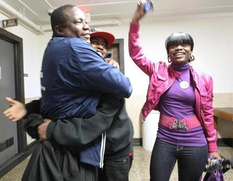 Victims' family members, from left, Elvis Martin, Ebony Flonory, and Sharnita Jones celebrated outside the courtroom after Dwayne Moore was sentenced to life in prison for the Mattapan massacre.