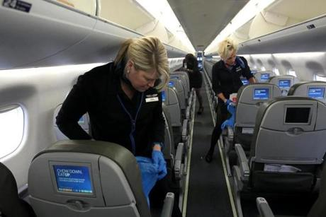 All JetBlue employees on a flight, whether they are flight attendants like Tara McCarthy and Tracy Christoph or the chief executive, start cleaning right after passengers leave.