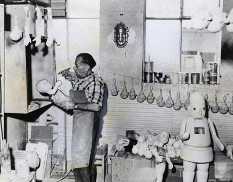 1959:  Expert touches on dolls were applied by a skilled artisan in the workshop of Christian Hofmann in Rodach, Germany. The