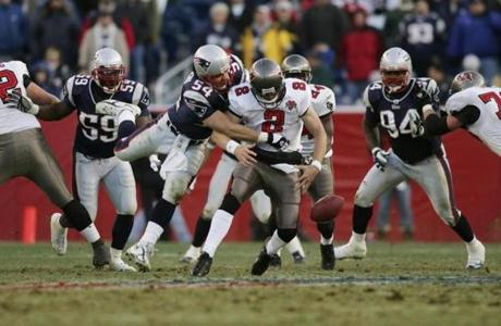 Tedy Bruschi knocked the ball out of Tampa Bay quarterback Chris Simms during the third quarter.