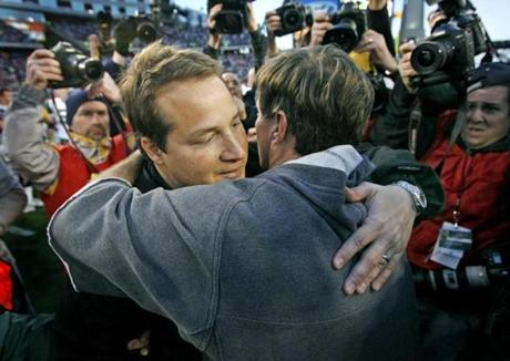 Patriots coach Bill Belichick hugged his former pupil, Jets coach Eric Mangini, after the game.