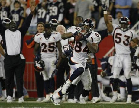 Denver's sideline celebrated as Javon Walker headed for the end zone on an 83-yard TD reception.