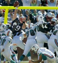 Mike Wright (99) got high enough to block this Dolphins field goal attempt.