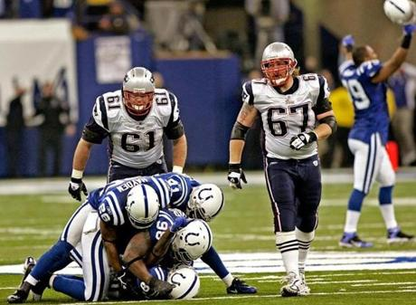 Patriots offensive linemen Stephen Neal, right, and Dan Koppen could only look on as Colts teammates piled on Marlin Jackson following his game-clinching interception.