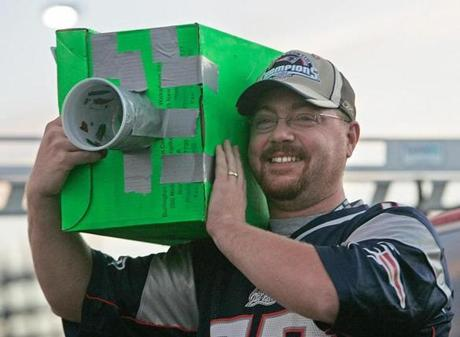 Patriots fan Mike Barry Jr. of Wakefield brought a homemade video camera to the game.