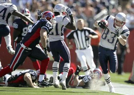 Wes Welker tucked inside the sideline as he returned a second-quarter punt.