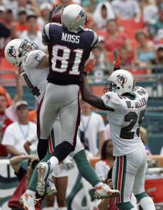 Randy Moss out-jumped Dolphins defenders for this 35-yard touchdown catch.