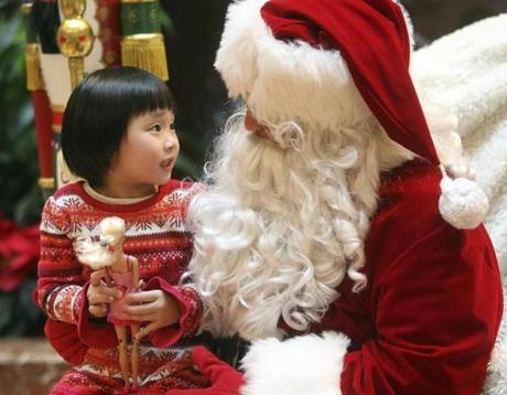 Boston- Friday, December 21, 2012- Lynne Inguyen, 4, of Boston, told Globe Santa of her Christmas wishes at Copley Place. (Mary O'Connor for The Boston Globe)