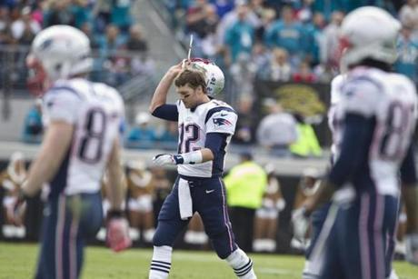 Tom Brady walked off the field after throwing his second interception against the Jacksonville Jaguars on Sunday.