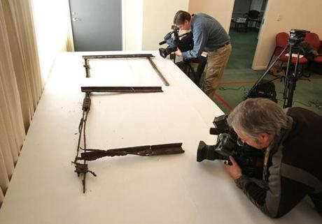 Cameramen shot video of rusted wall frames on display at a Massachusetts Department of Transportation press conference on Monday. Workers removed 117 wall panels in the Callahan Tunnel due to concerns about corroded bolts.