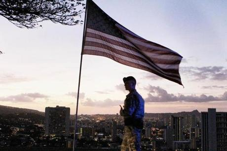 Dawn broke over downtown Honolulu as an army military policeman walked around the perimeter of National Cemetery of the Pacific on Sunday. Memorial services were held there for the late US Senator Daniel K. Inouye.