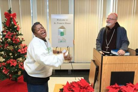 Cardinal Sean P. O'Malley led a special Christmas service at St. Francis House in Boston on Christmas Day. At the conclusion of the service, Lisa Marie Jenkins stood up and sang O'Malley an improvised song of thanks.