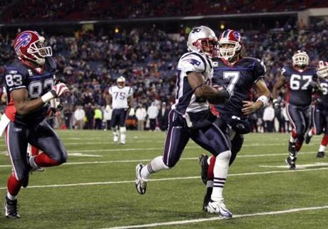Ellis Hobbs returned a fumble 35 yards for the Patriots' final score in the fourth quarter.