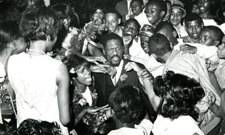 June 22, 1966: Bill Russell was mobbed by young fans after he gave the commencement address at the Patrick Campbell Junior High School's
