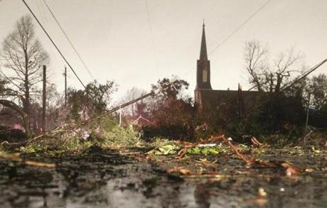 Downed trees and power lines covered a street in Mobile, Ala. on Tuesday.
