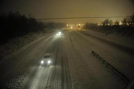 Motorists traveled slowly on a snow-covered Interstate 24 during a in Paducah, Ky, on Wednesday.
