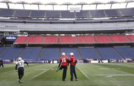 Tom Brady (right) chatted with backup quarterback Ryan Mallett during practice at Gillette Stadium on Thursday