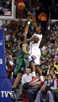 DeAndre Jordan shoots over the Celtics' Jason Collins in the second half of the game.