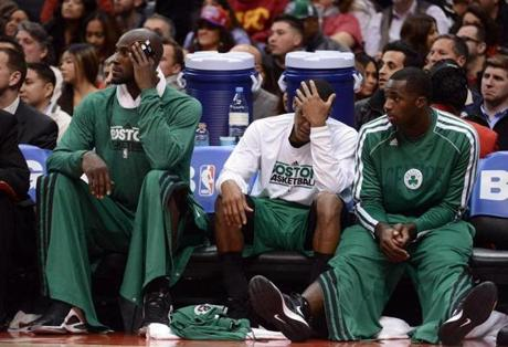 From left: Kevin Garnett, Rajon Rondo, and Brandon Bass of the Celtics watched from the bench during their loss to the Clippers.