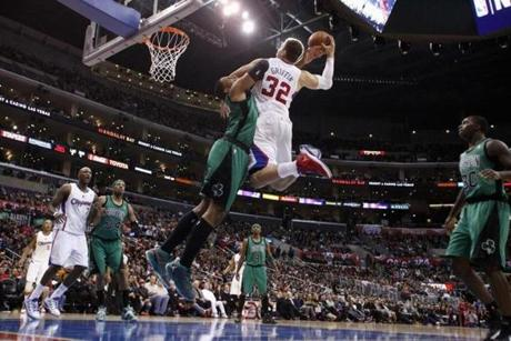 Celtics' Jared Sullinger was called for a flagrant foul as Los Angeles Clippers' Blake Griffin attempted a dunk.