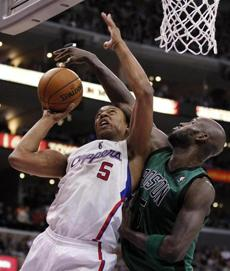 The Clippers' Caron Butler went to the hoop as Garnett defended.