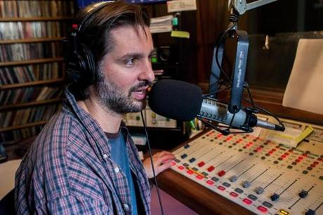 "P.J. Finn, WMVY program director and DJ, says the station is part of the island community: ""It makes it seem as though the music is coming from someplace, not just springing from a hard drive."""