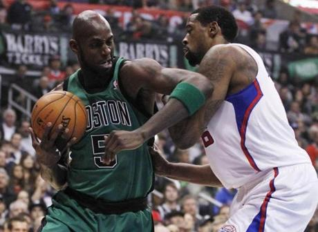 Boston Celtics' Kevin Garnett took the ball around Los Angeles Clippers' DeAndre Jordan during the first quarter of their game in Los Angeles.