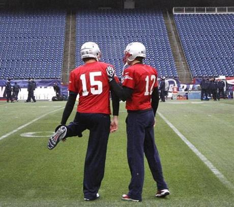 Tom Brady chats with backup Ryan Mallett during the Patriots' workout.