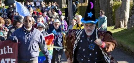 Allan Moniz, dressed as magician Propero, paces the 2012 Woods Hole Parade on New Year's Day.