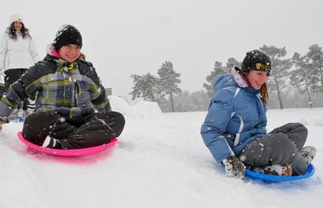 Children went sledding in Minersville, Pa. on Friday.