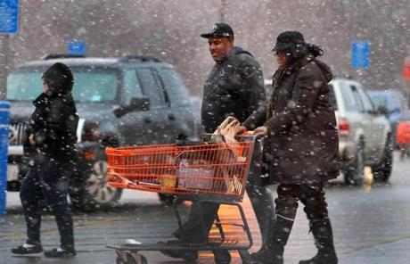 Snow fell on shoppers leaving the Home Depot in Avon.