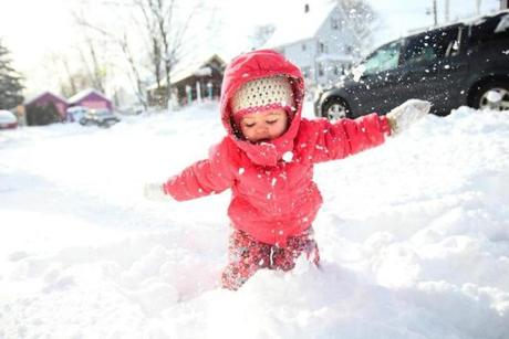 Marcella Bourasa, 2, of Milford experienced her full snowfall on Dec. 31, while her mother, Laura Bourassa, 28, admonished her not to eat the snow.