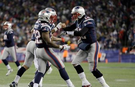 Tom Brady congratulated Stevan Ridley after Ridley's second rushing touchdown of the game.