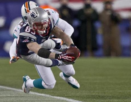 The Patriots' Wes Welker dove for a first down but came up short as the Dolphins' Reshad Jones pushed him out of bounds.