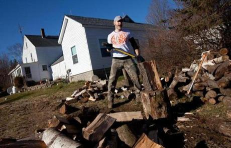 Erik Jacobs split wood for the farm's wood-fired boiler last month.