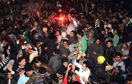 Pakistani youths celebrated early on Jan. 1 on a street in Lahore.