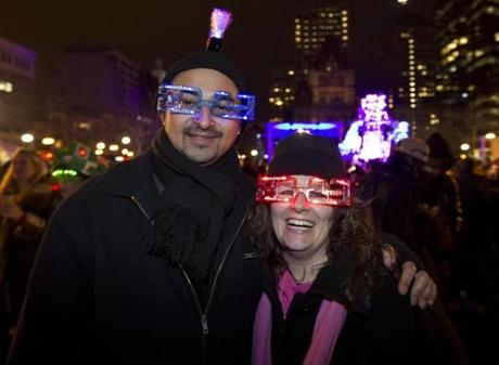 LOOKING AHEAD: Justin Lowery and Julie Dixey of Weymouth in Boston's Copley Square for First Night festivities on December 31