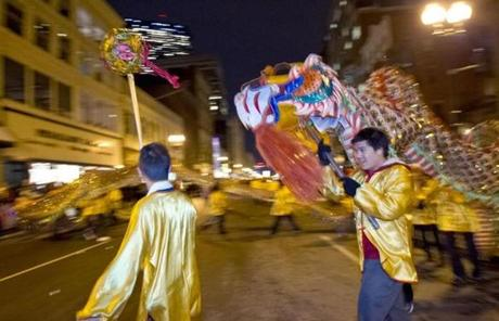 Lion dancers with the Greater Boston Chinese Cultural Association performed on Boylston Street.