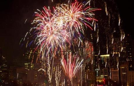 Fireworks exploded over Boston Common Monday night as revelers crowded Boston for the annual First Night celebration.