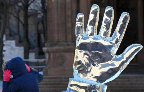 An ice sculpture of cold hands in Copley Square was appropriate to the temperature on First Night.