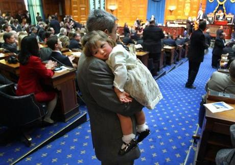 Representative Ted Speliotis from Danvers held his granddaughter, Kayla Freeley, 15 months, in the aisle of the House chamber of the State House after members of the 188th General Court were sworn in.