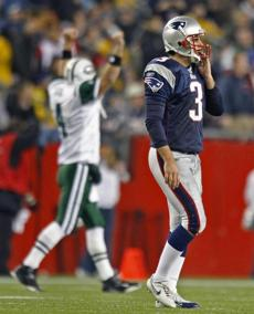Stephen Gostkowski slumped off the field after Leon Washington ran back a kickoff for a touchdown in the first half.