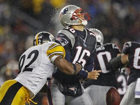 Steelers linebacker James Harrison twice forced fumbles by Matt Cassel in the third quarter.